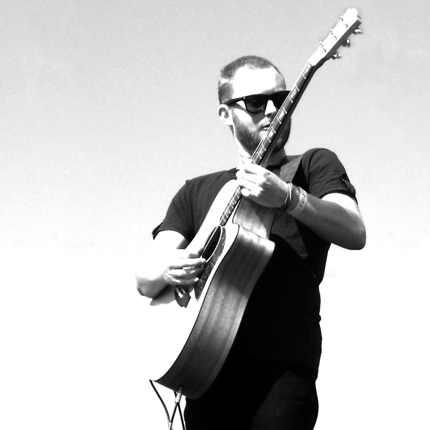 Marcus Wynwood playing his acoustic guitar at the Devonport Food and Wine Festival